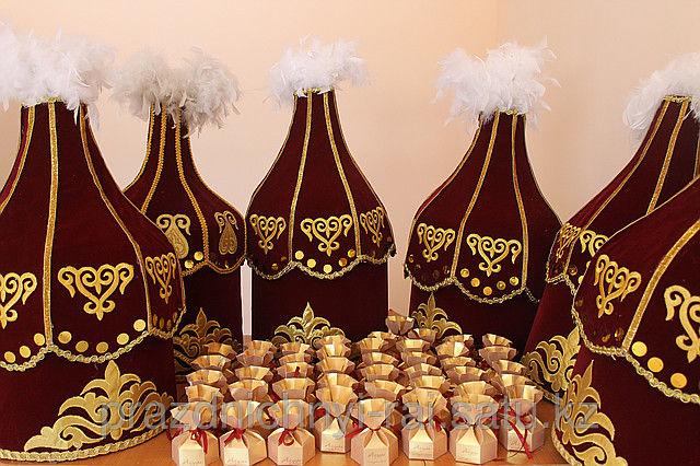 Как будет на казахском подарок